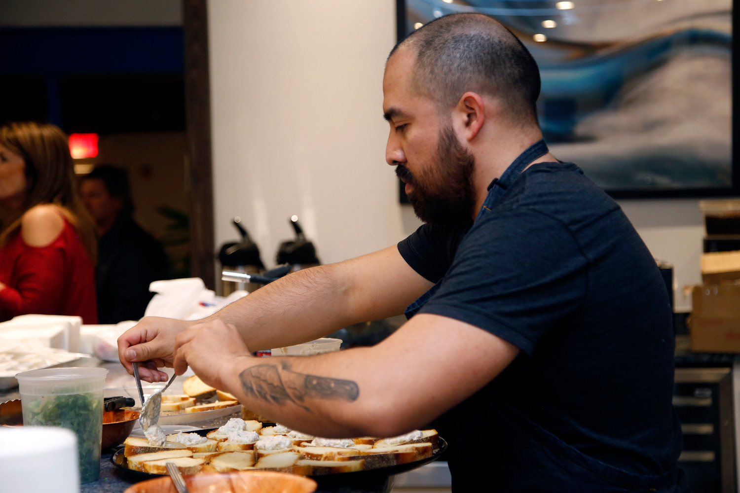 Long Beach Chef Ronnie Jaramillo prepares Baba Ganoush appetizers.