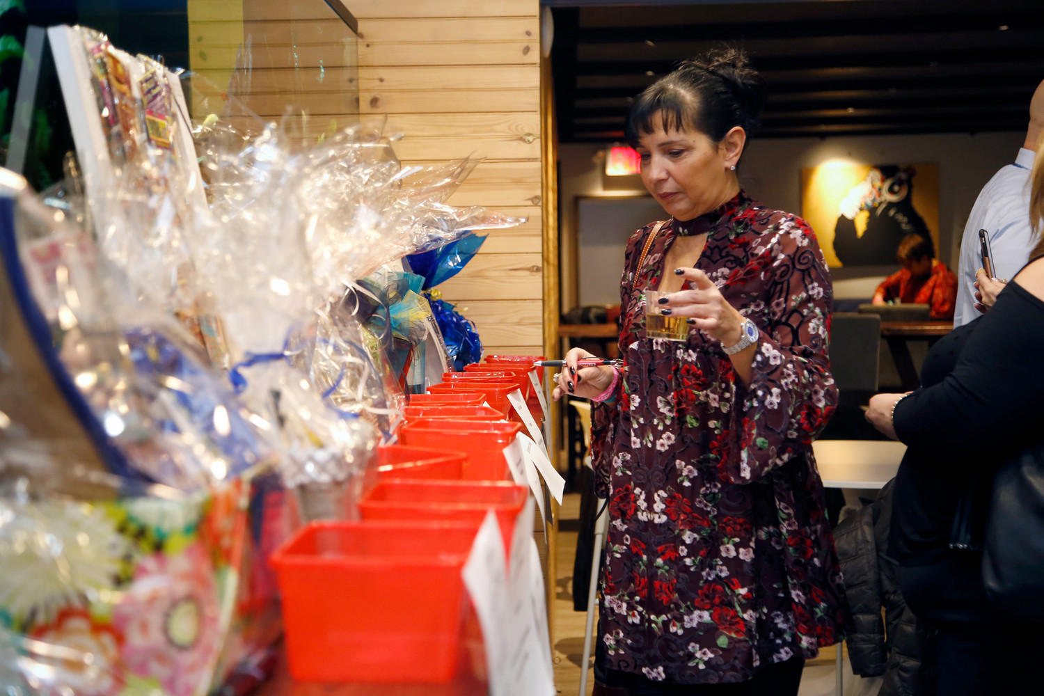 Cathy Acquavella browsed the raffle baskets.