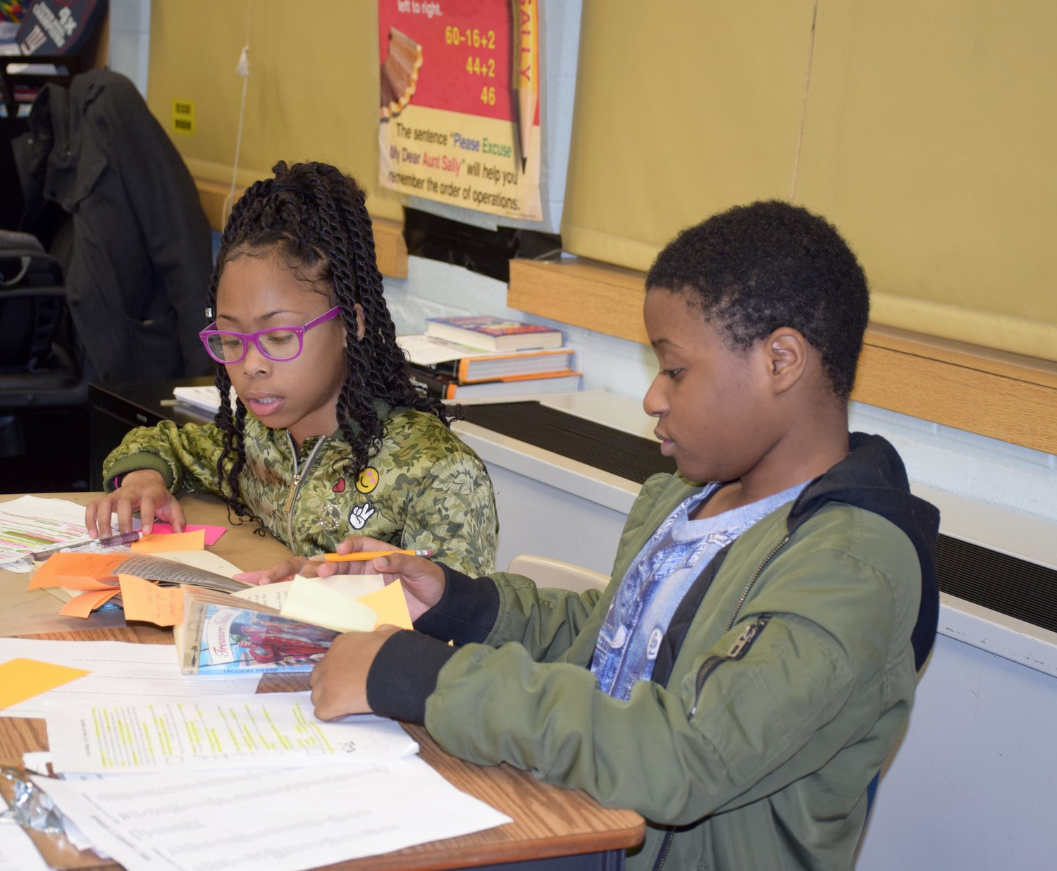 Sixth-graders Aliana Bryan and Umar Ahmed reviewed vocabulary during a recent class lesson.