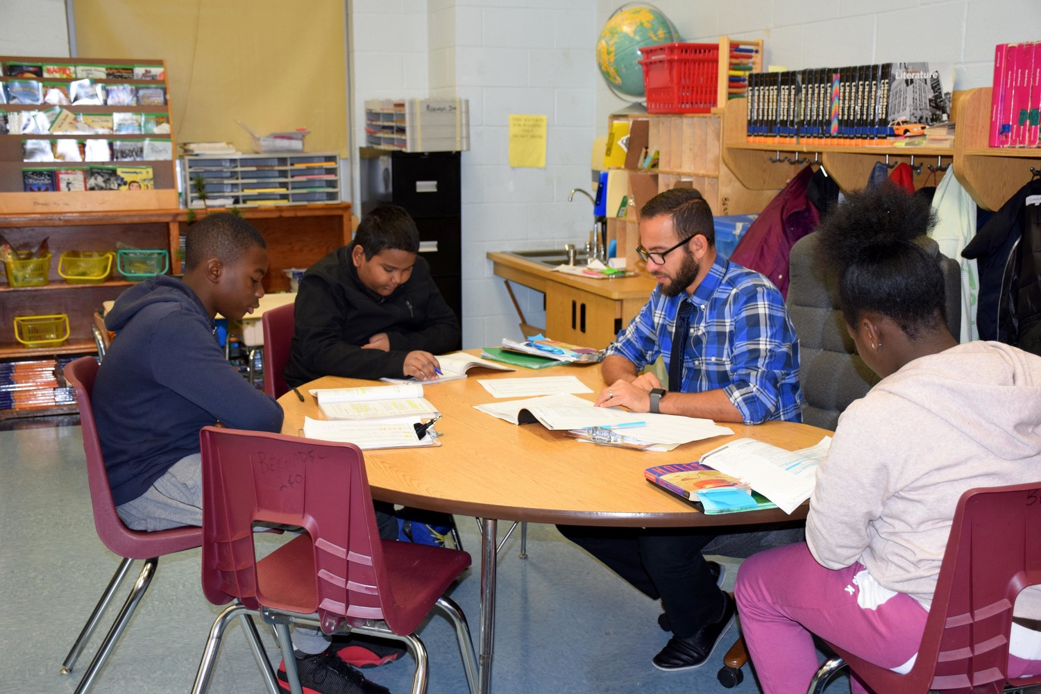 Dimitri Bernadel met with students during a recent ELA lesson.