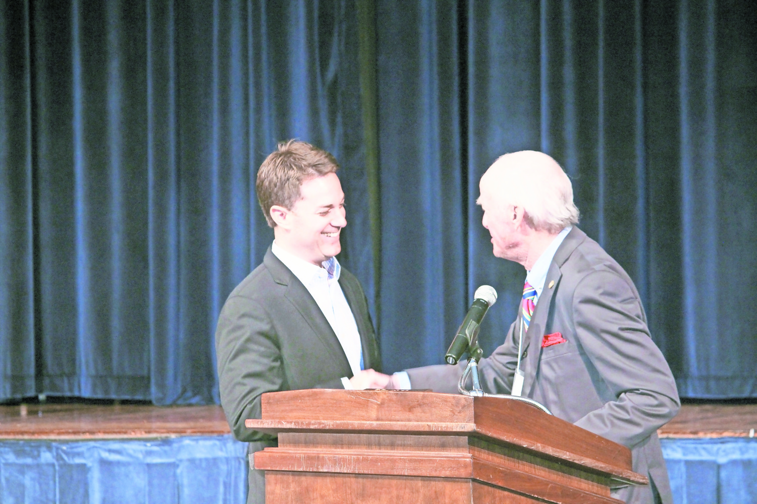 President of CBS Sports, David Berson, left, was congratulated by Board of Education Trustee Stephen Witt at last year's Hewlett-Woodmere Alumni Association Hall of Fame induction ceremony.