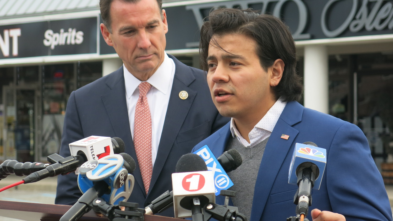 "Nelson Melgar, right, a ""Dreamer,"" said at a news conference held by U.S. Rep. Tom Suozzi that he initially had difficulty processing the offer made by the congressman for him to go to the State of the Union address."