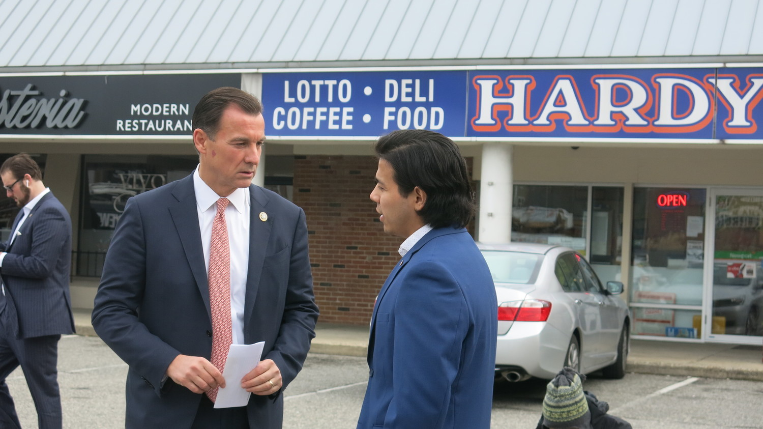 "Nelson Melgar, a ""Dreamer,"" and U.S. Rep. Tom Suozzi spoke in front of Hardy's QuickMart, where Melgar once worked."