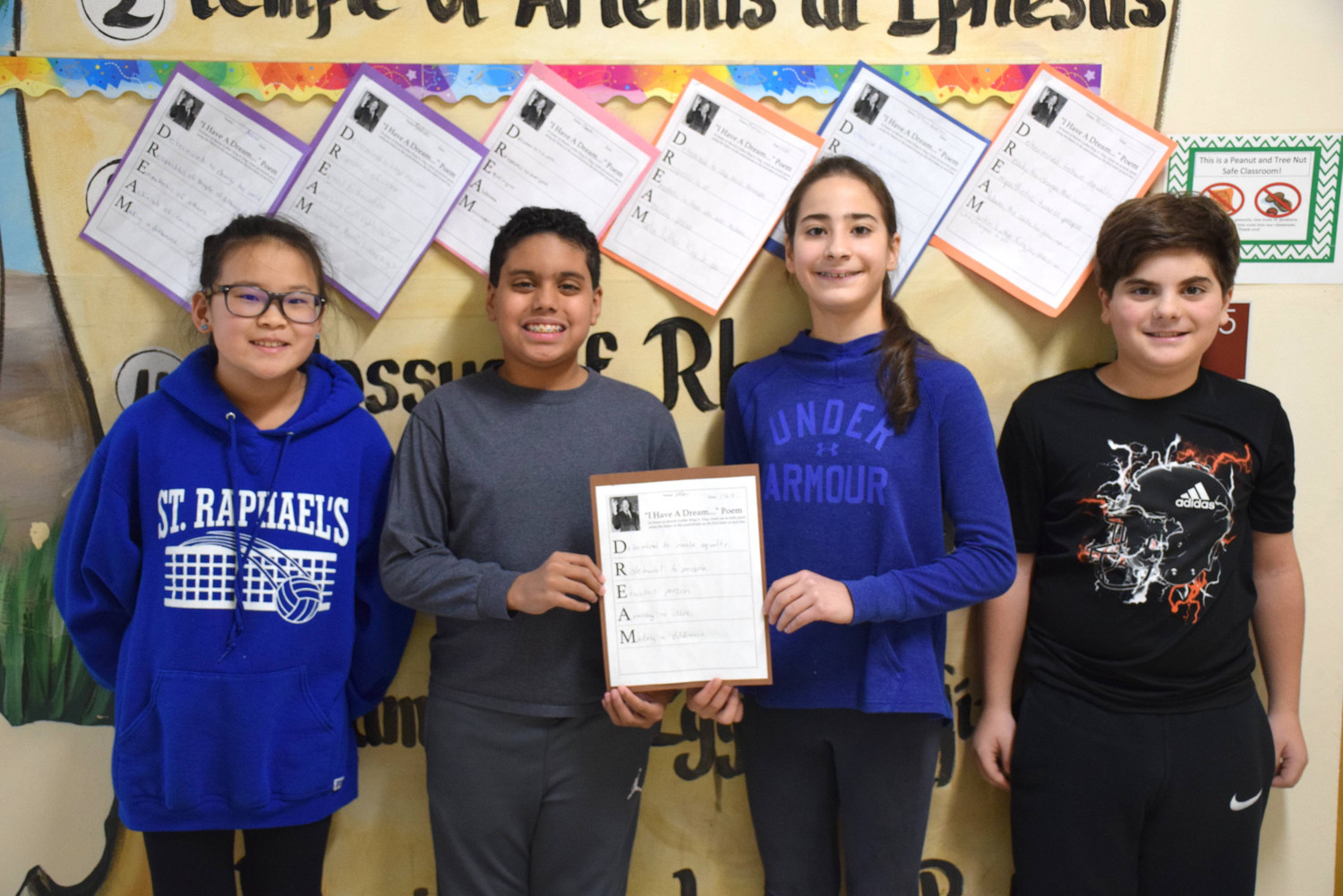 "Sixth-graders, including Melissa Hellman, left, Jeremy Lazaar, Christiana Foufas and Matthew Folise wrote acrostic poems using the word ""dream."""