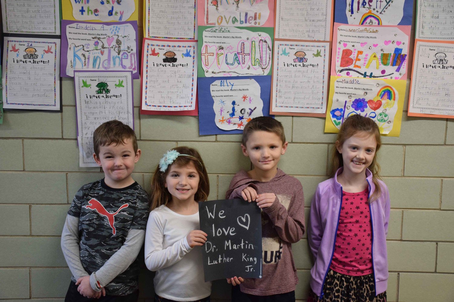 First-graders Billy Gazsy, left, Garifalia Vatougios, Brendan Radicone and Maddie Burns analyzed Dr. King's dream.