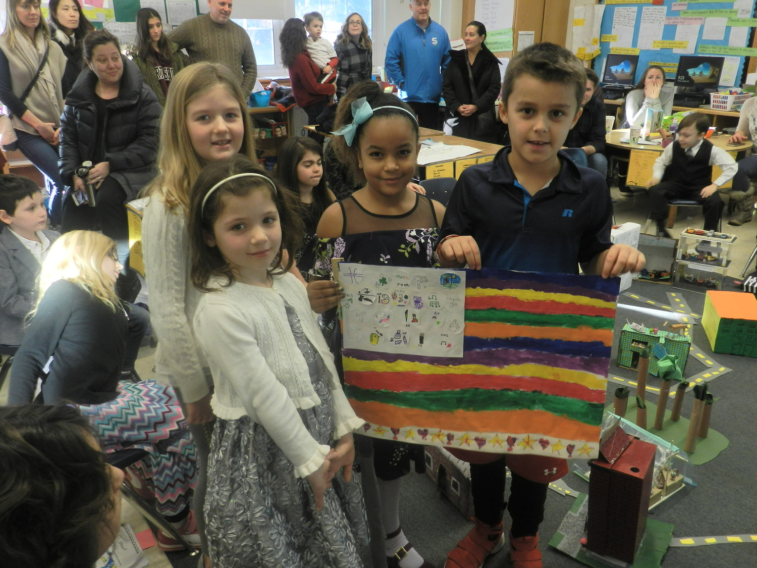 From left: Megan Matthews, Georgia Deegan, Jasenia John and Marco Camps worked together to create a flag for their community.