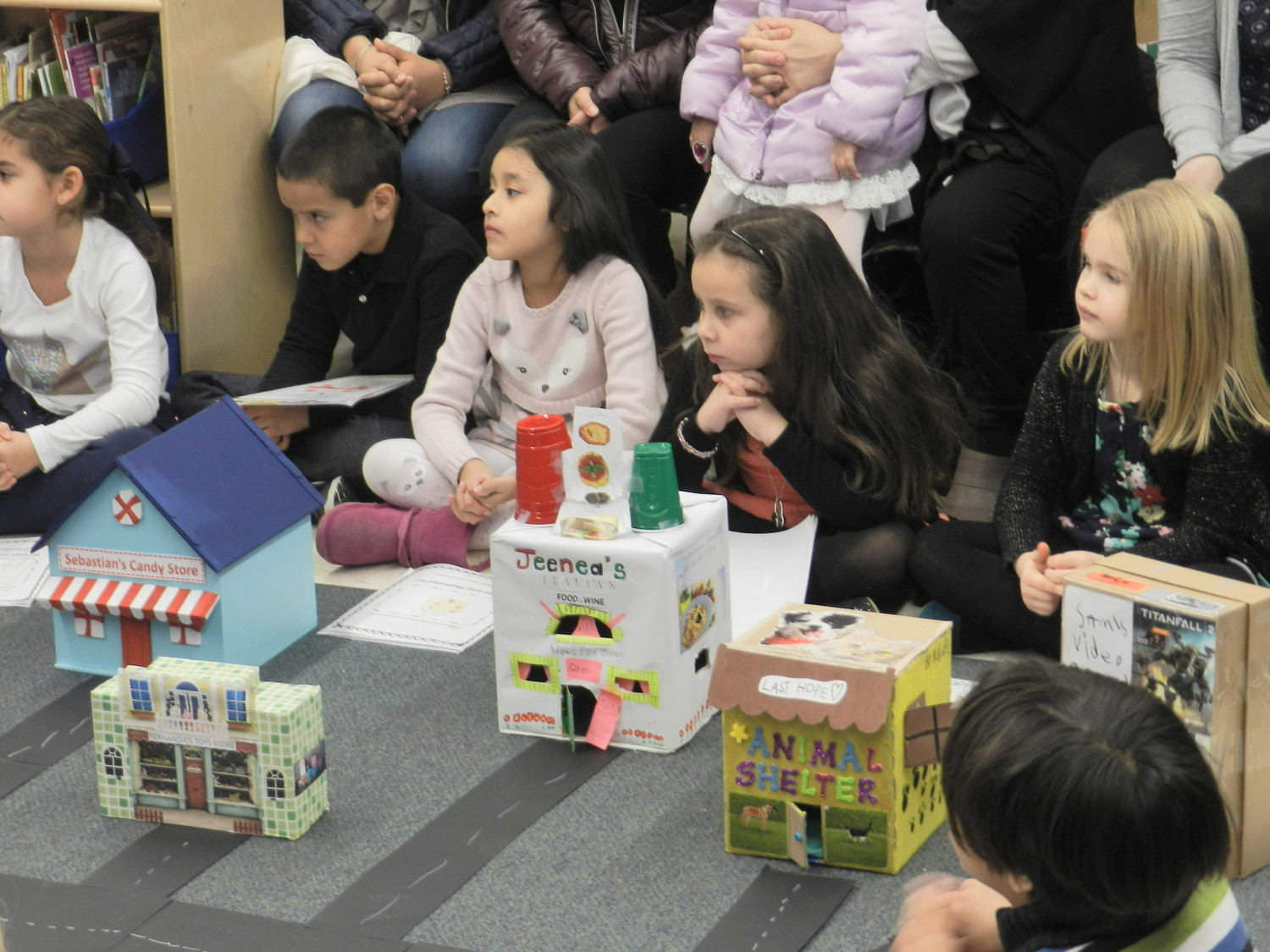 Erin Morley's students turned cardboard boxes into commercial buildings, including a candy shop, a toy store, and an animal shelter, to construct an urban community.