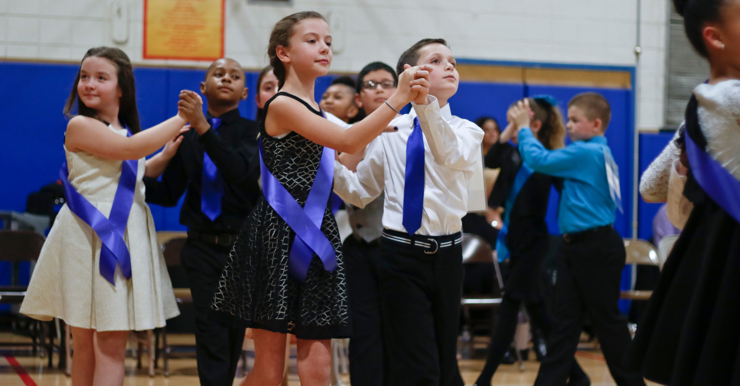 Maggie Batkin and Charlie Piscatelli, center, were among the dancers representing Covert Elementary School at a ballroom dancing competition in Port Washington on Jan. 24. Behind them to the left, their classmates, Julia Coles and Lamont Briggs, showed off their skills.