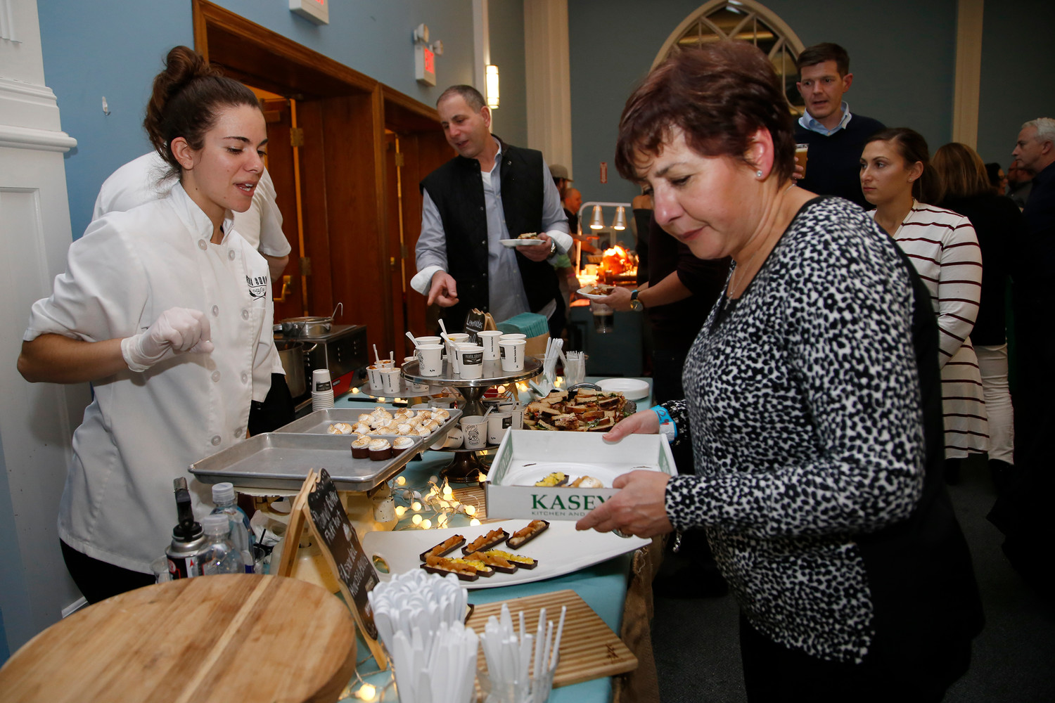 Brittany Improte, of The Flour Shoppe Cafe, offered goodies to Michelle Vitalo at the Taste of Rockville Centre event on Jan. 26.