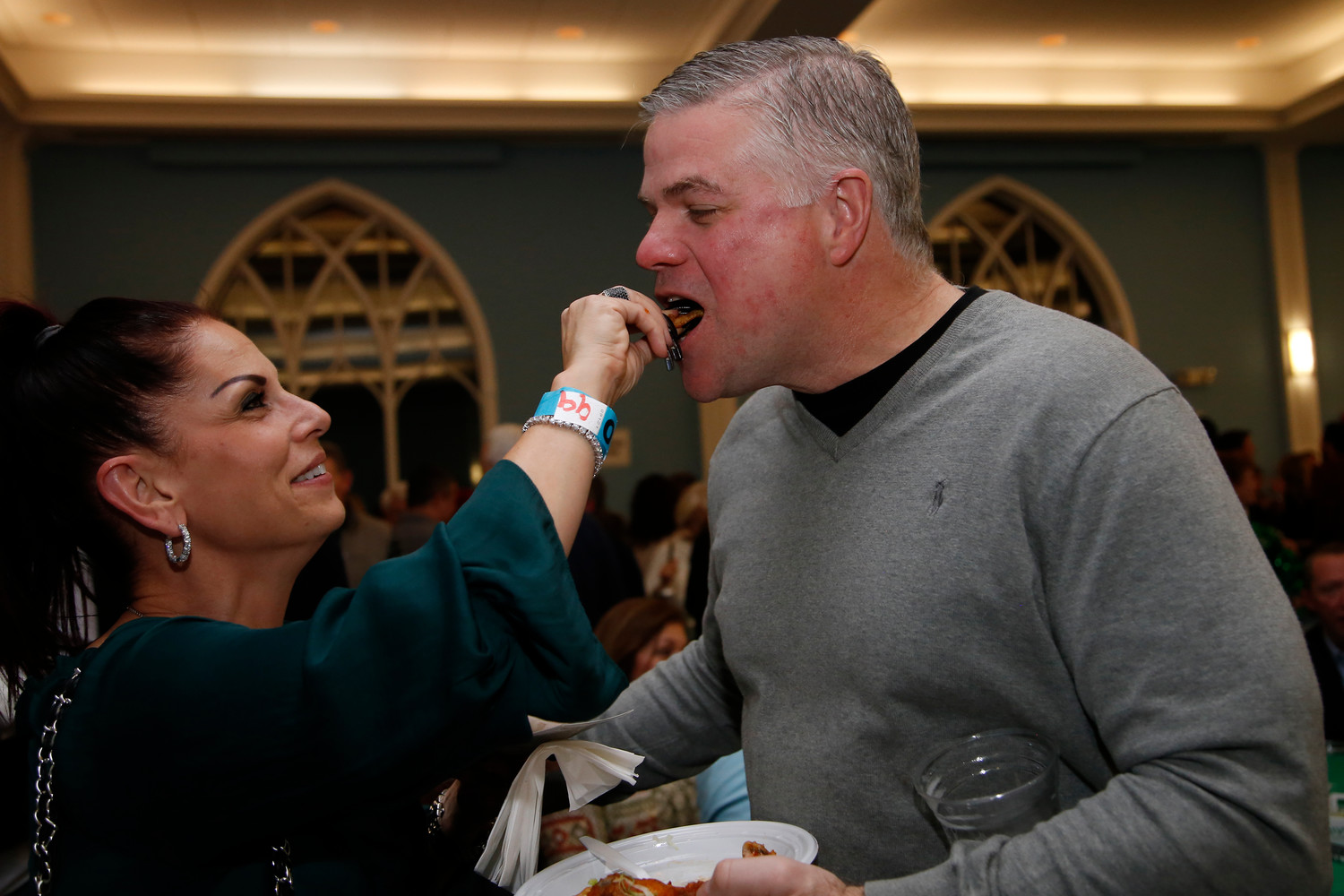 Rockville Centre resident Andrea Connolly gave her husband, Larry, a taste of her fried wonton.