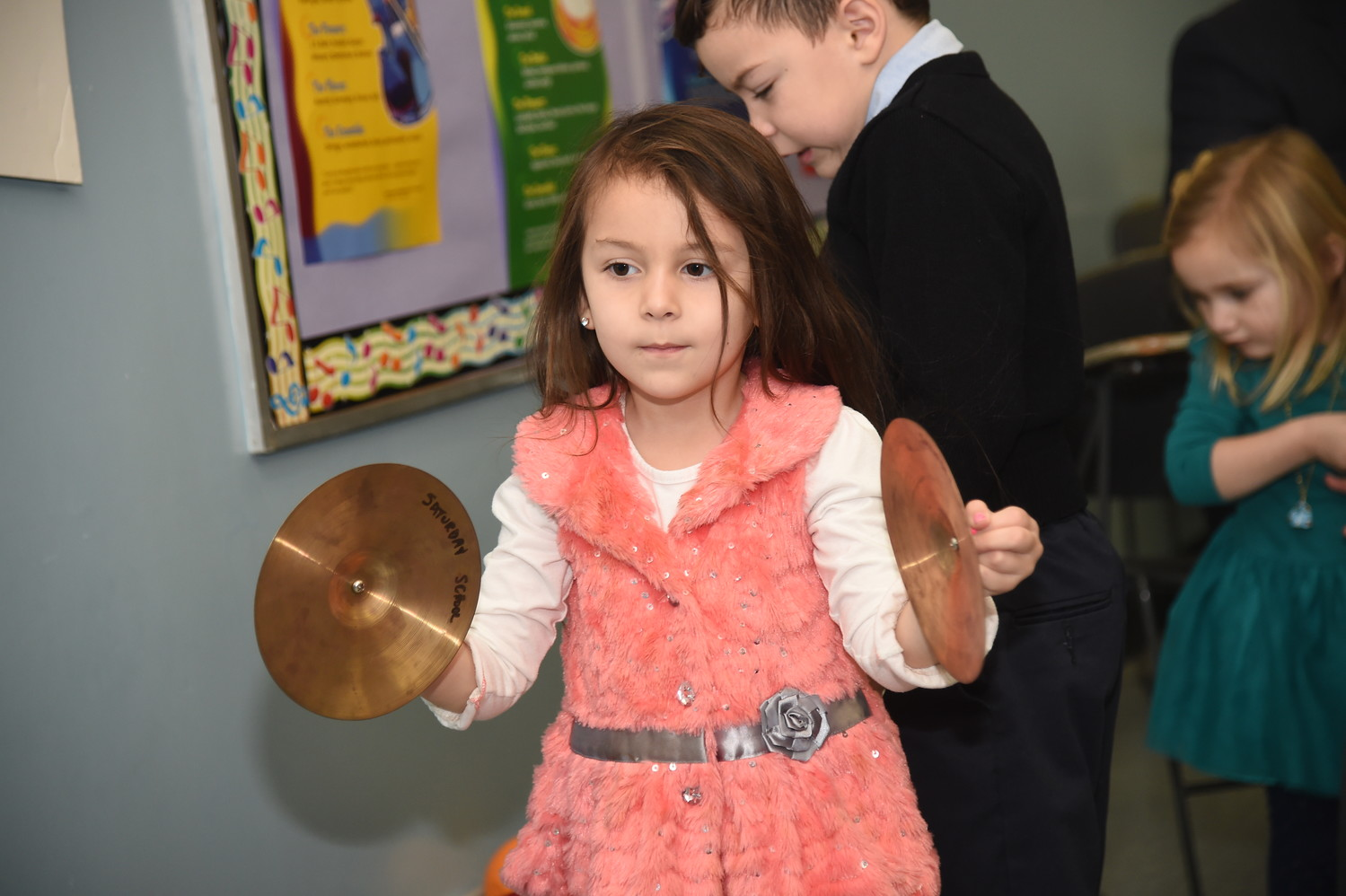 Madeleine Kucharnik, 4, tried playing an instrument at the Open House.