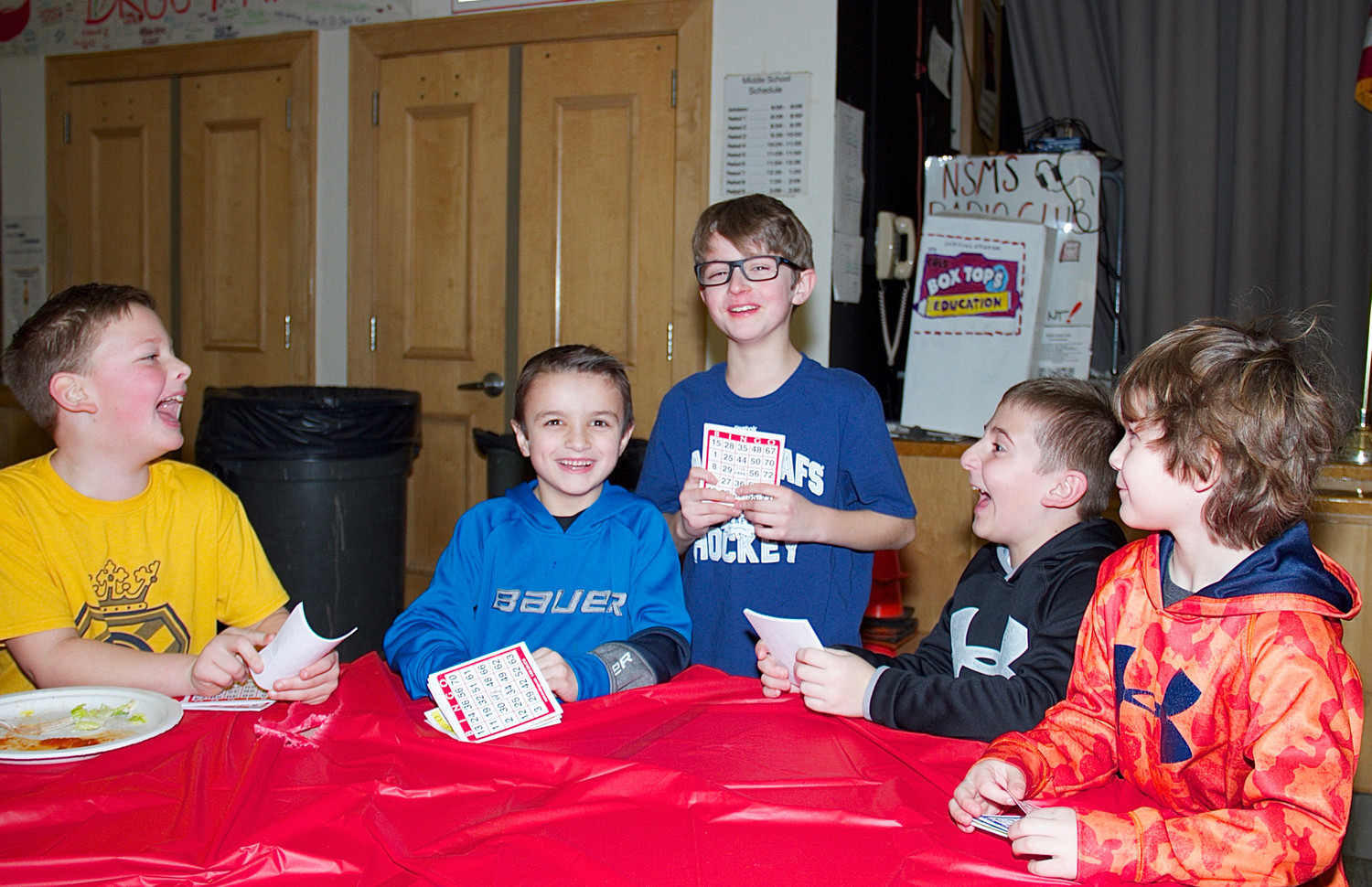 From left: Third grade students Brady Ayres, Brok Dergarabedian, John Peck, Steve Panagopoulos, and Luca Armata engaged in a rousing round of Bingo.
