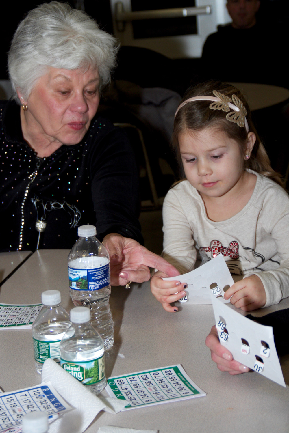 Carol DeAngelo helped her granddaughter Ava DeVito, 4, mark up her Bingo card.