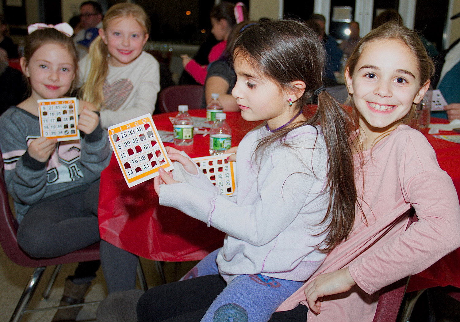 From right: Third graders Manuela Armata, Allessandra Gallo, Evangeline Weinstein and Madison Petersen anxiously awaited to have their Bingo numbers called.