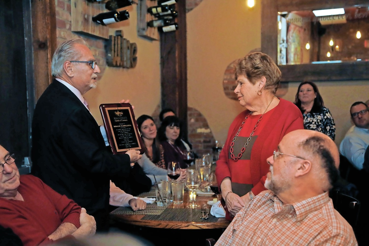 Members of the chamber listened as Chamber Trustee Jack Sorrentino honored Rosalie Pampillonia.