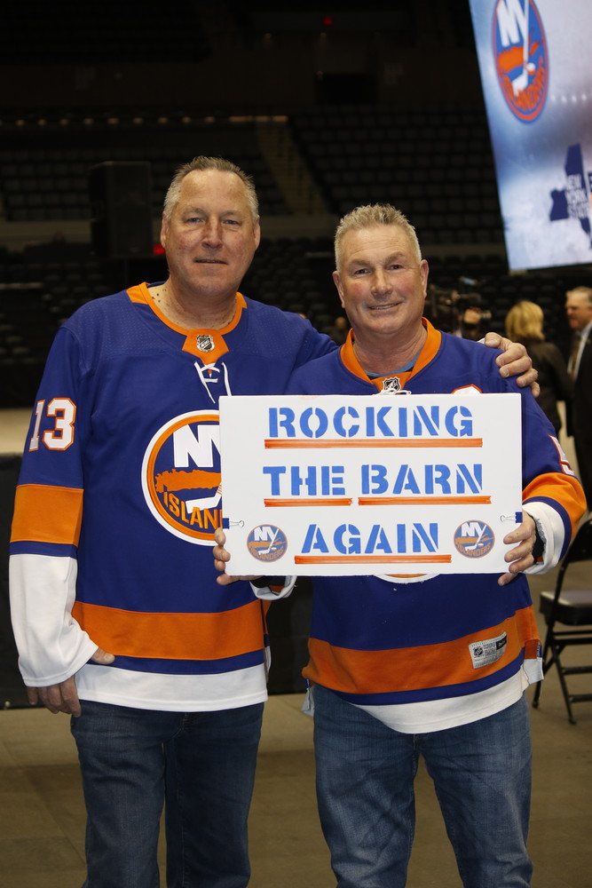 Islanders fans Bob Miernicki, of Amityville, and Patrick Dowd, of Bayshore, celebrated the team's return to Nassau Coliseum at a news conference on Jan. 25, in which Gov. Andrew Cuomo announced that the Isles will play 60 games at the newly renovated venue over the next three seasons.