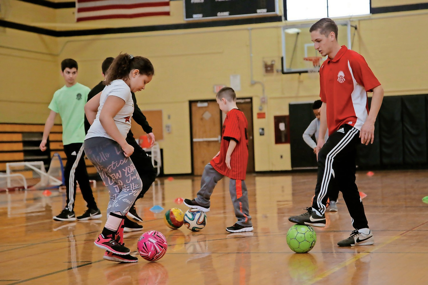 Nick Tornambene, a trainer with the West Hempstead Chiefs Soccer Club, taught Logan Colnick, 9, basic footwork on Feb. 4.