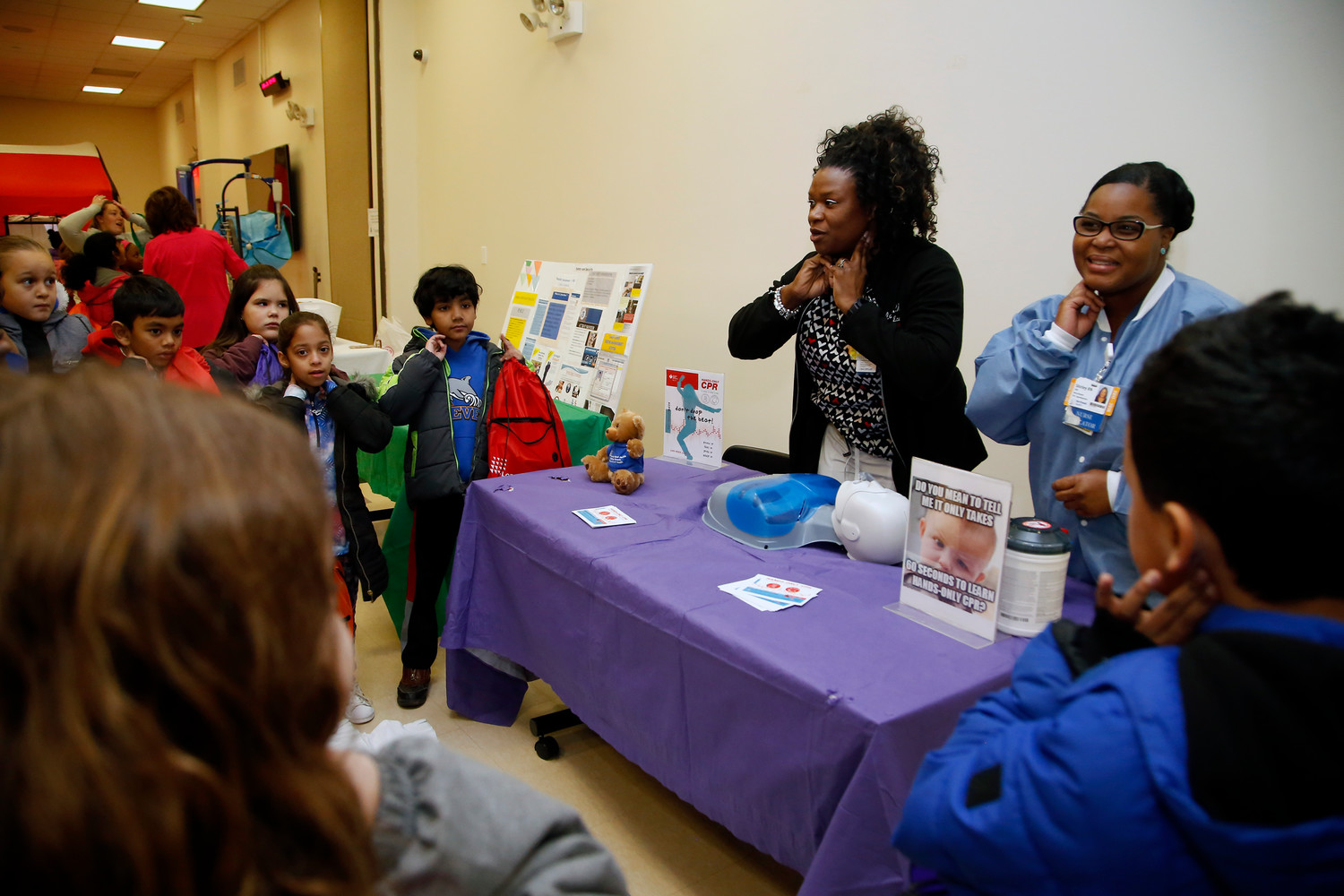 Carolyn Wiltshire and Shirley Hill, right, showed third-graders how to find a pulse at Long Island Jewish Valley Stream's second annual Safety Fair.