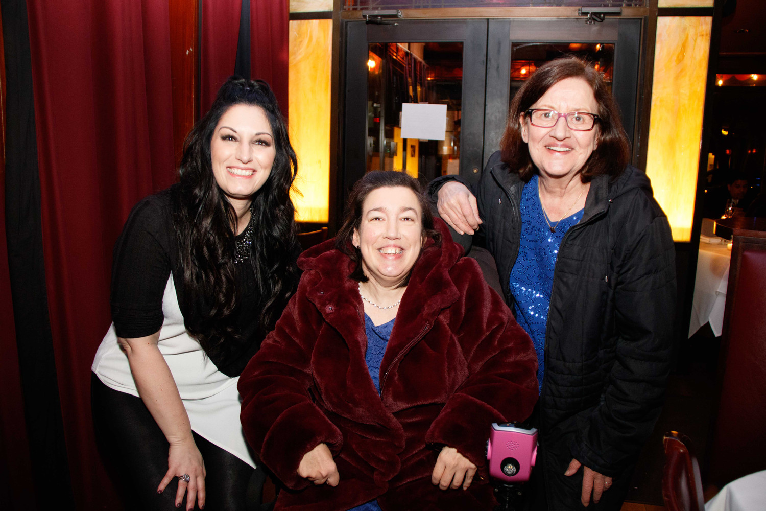 Niki Sorrentino fundraised to help those with Cerebral Palsy, such as her friend Francesca Dindo. They are pictured here with Dindo's mother, Kathe.
