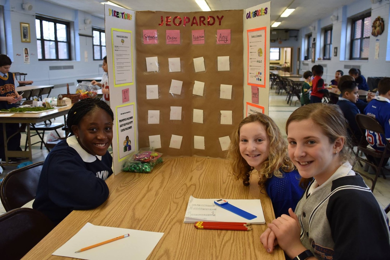 Sixth-graders at St. Raymond's made math-based board games for students in other grades to play during Catholic Schools Week.
