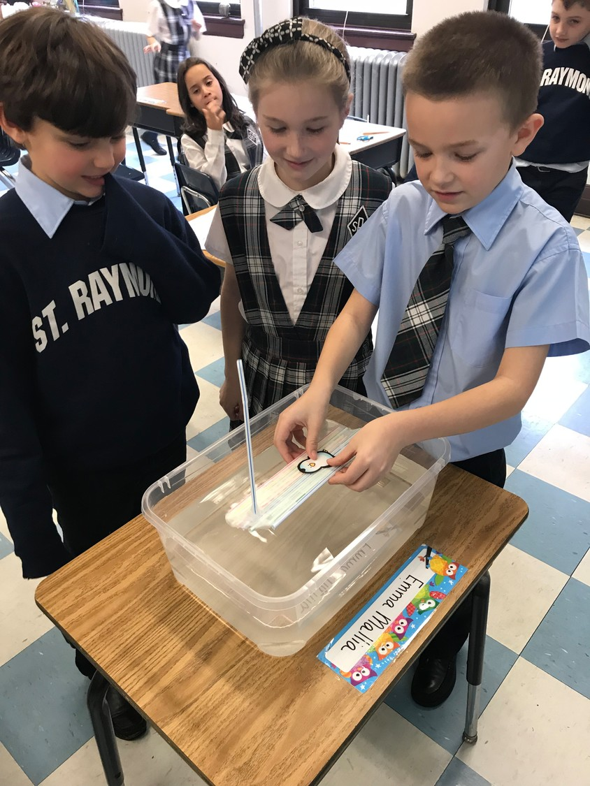 Second-graders at St. Raymond's Parochial School made rafts out of straws.