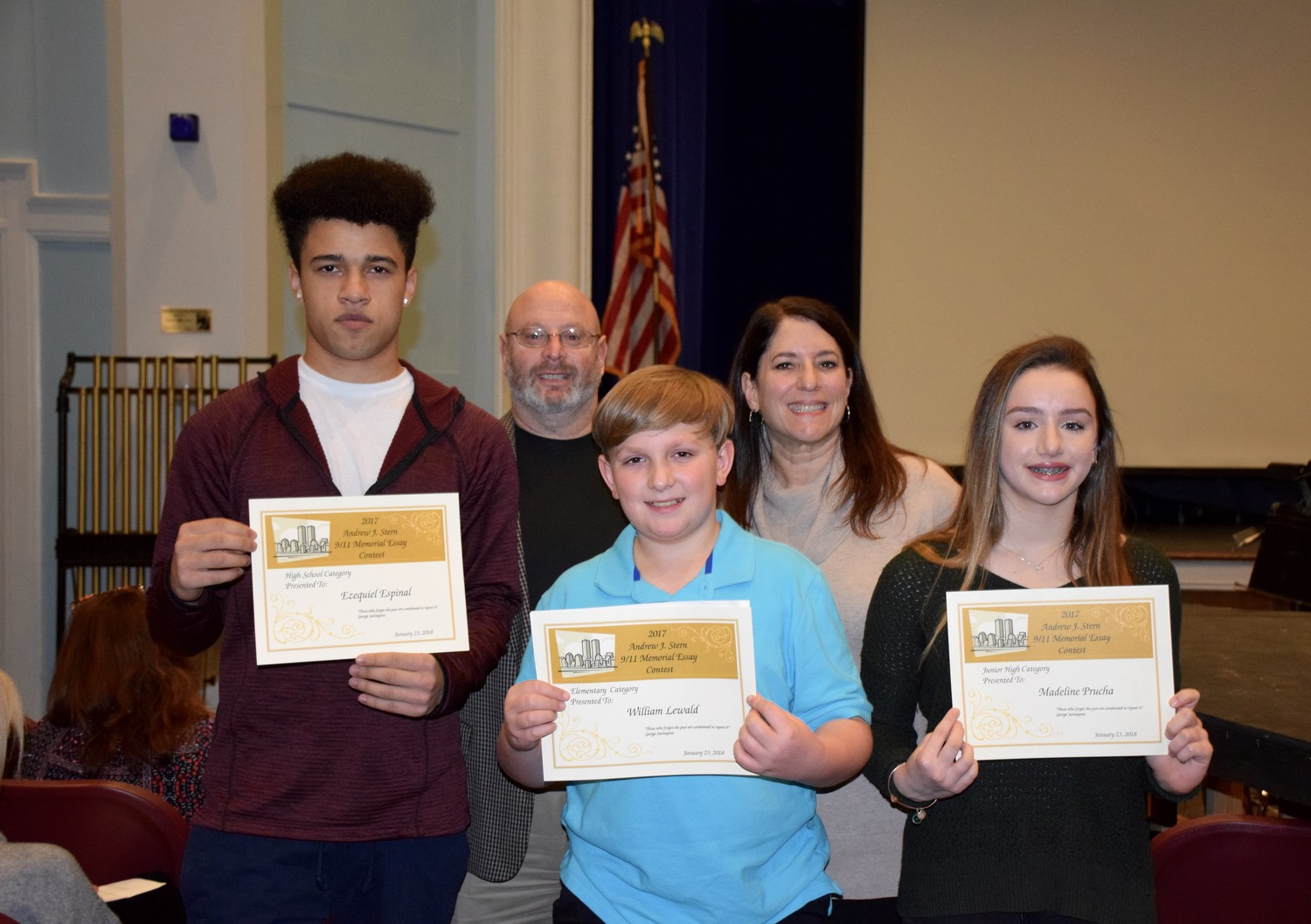 East Rockaway School District students Ezequiel Espinal, left, William Lewald and Madeleine Prucha were awarded for their entries into the annual Andrew Stern Memorial Essay Contest. Above, the students with Stern's family members, Michael Stern and Lisa Burch.