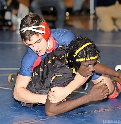 South Side junior Nick Shimkin, top, captured the 120-pound title at last Saturday's county qualifying tournament hosted by Oceanside.