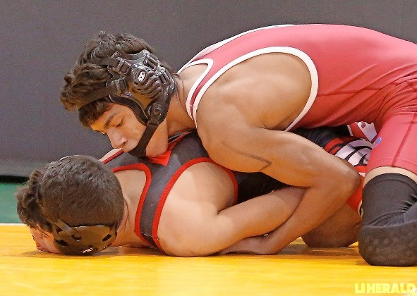 Glen Cove sophomore Isiah Jackson, top, captured the 99-pound title at last Saturday's county qualifying tournament hosted by Hewlett.