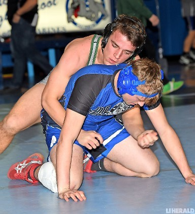 Senior Jack Krug, top, returned to action last Saturday following knee surgery and was one of five Kennedy wrestlers to capture a qualifying tournament title.