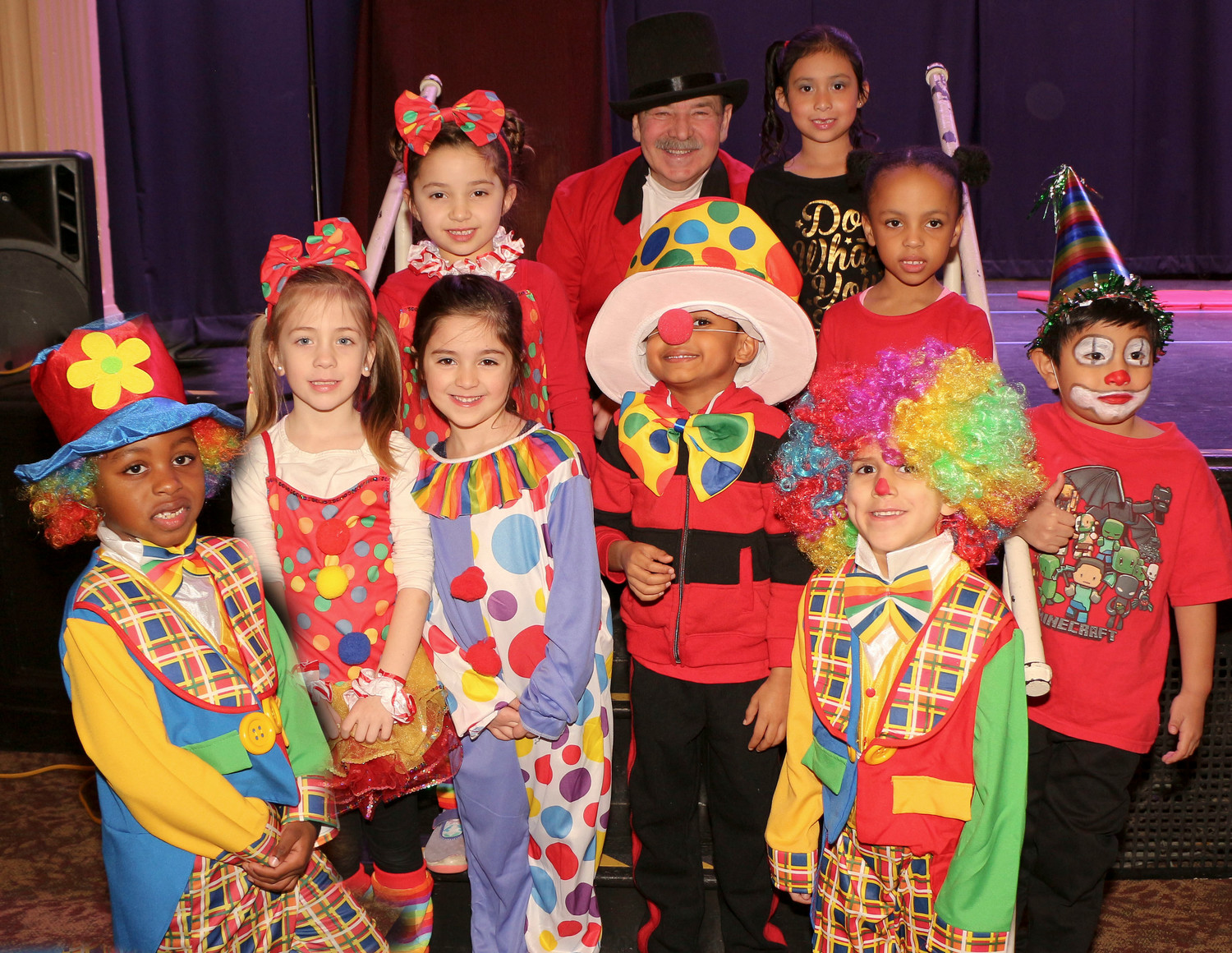 Ringmaster Tom Cavalieu, back center, a retired gym teacher also known as Mr. C, with his Kindergarten Clowns.