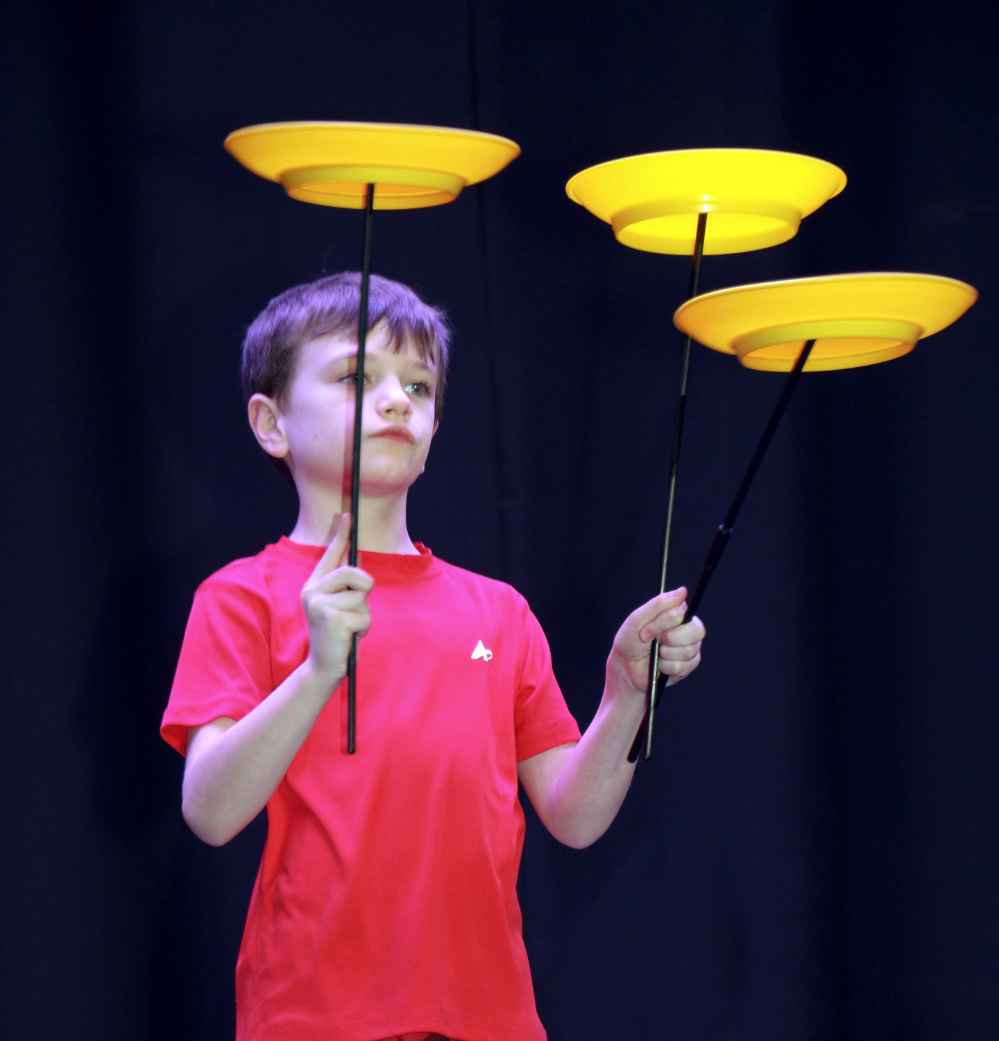 John Hassel, 8, twirled three plates at once.