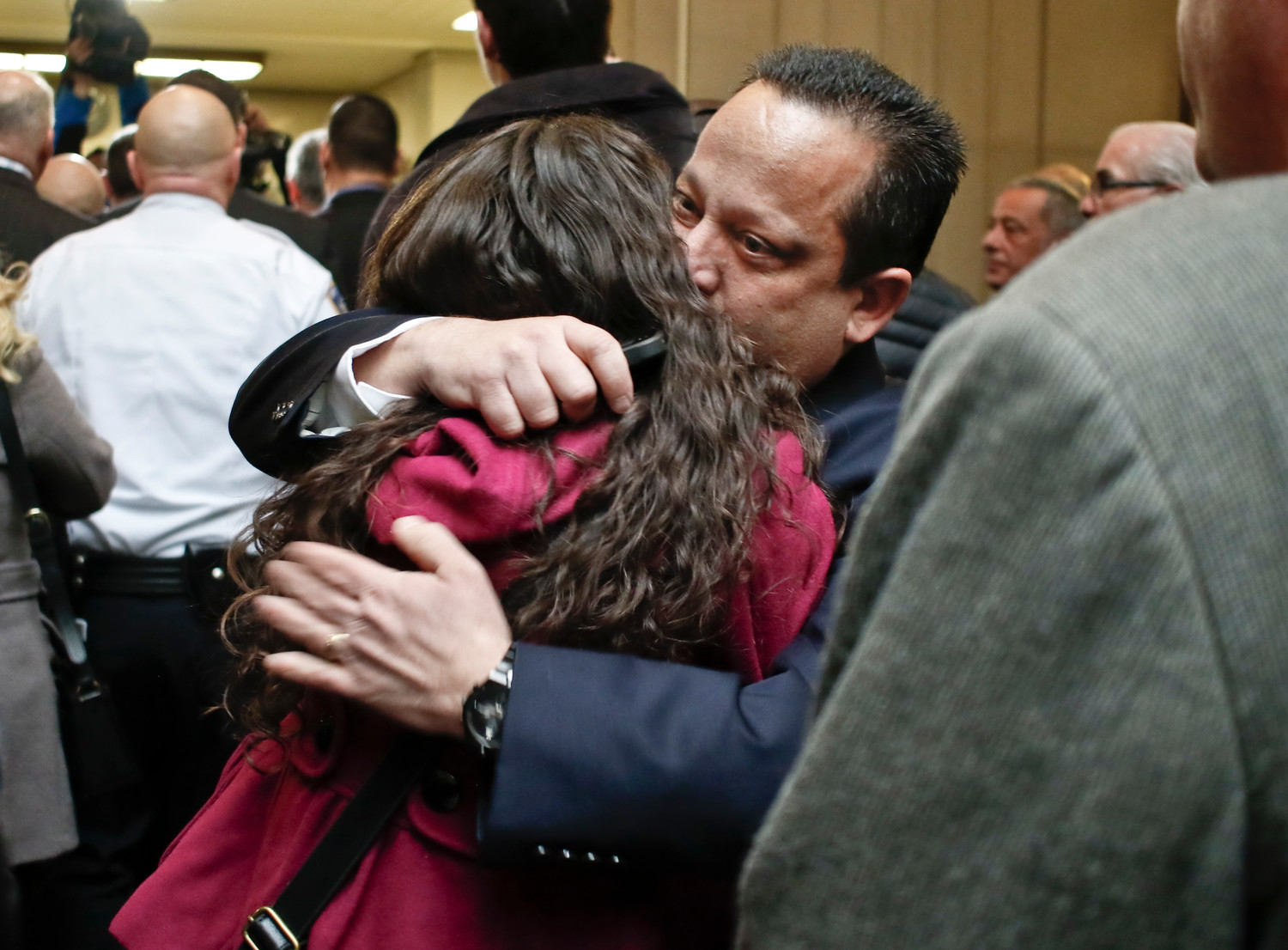 Federico's Brother, Paul, hugged Jennifer Giambrone, a paralegal who worked on the case.