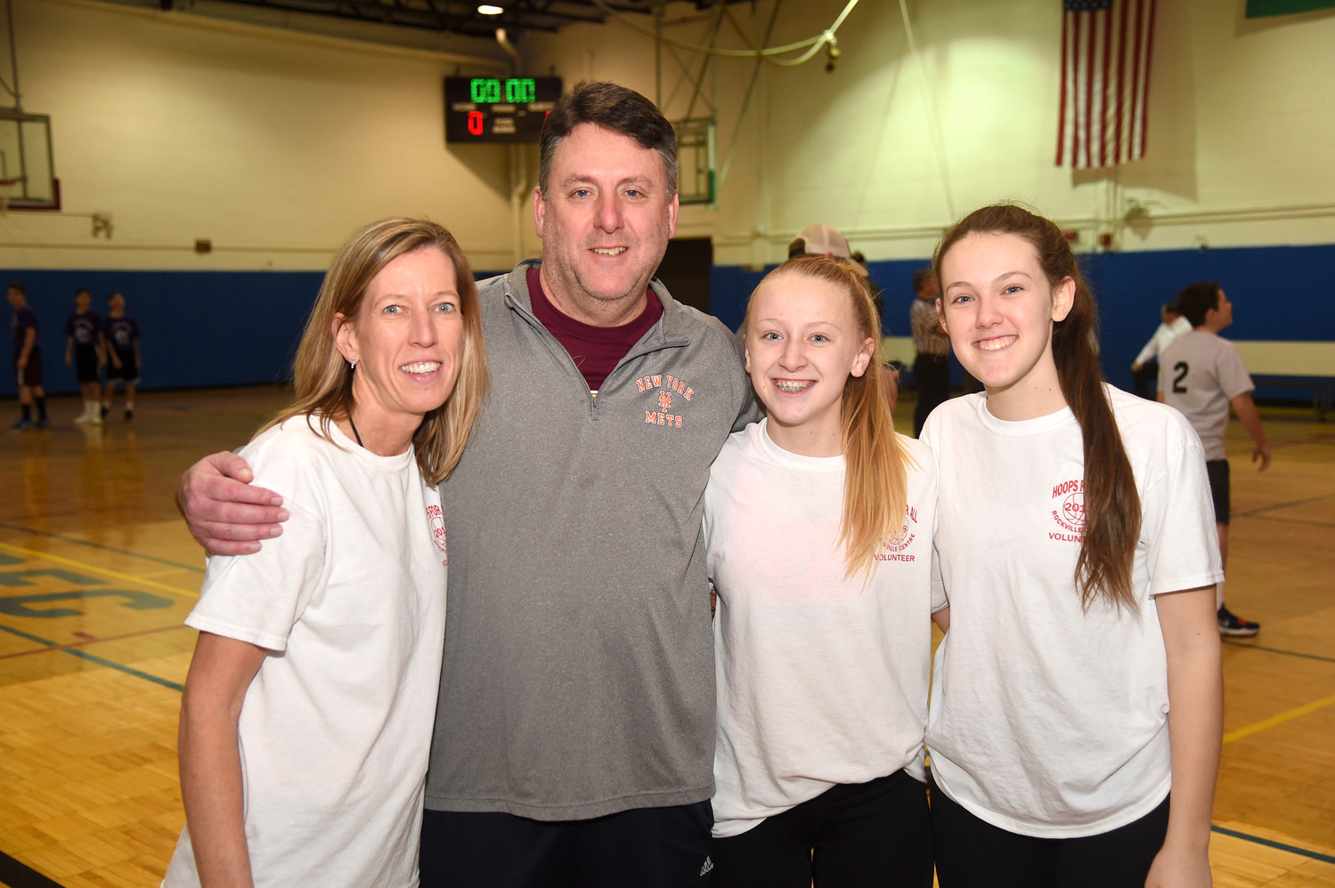Hoops For All Organizer Patty Basile, left, with her husband, Mike, and daughters Bridget, 13, and Maggie, 16