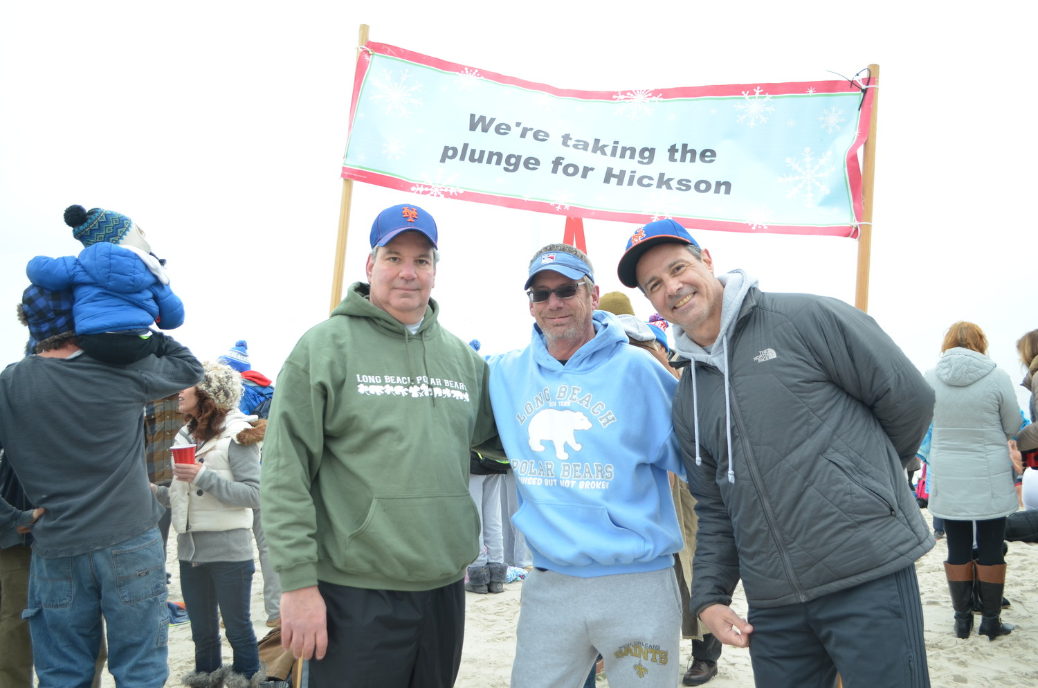 Bill Holtmeyer, left, Jim Whitten and Bill Phillips take the plunge every year to honor their late friend Dennis Hickson.