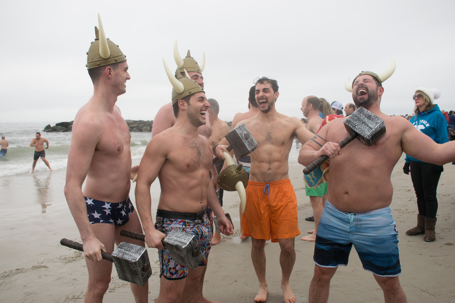 Lynbrook residents Steven DeSena, left, Craig Callabro, Neil Massioli, James O'Hanlan and a friend celebrated after donating to the Make-A-Wish foundation and taking the plunge for the fourth year in a row on Sunday.