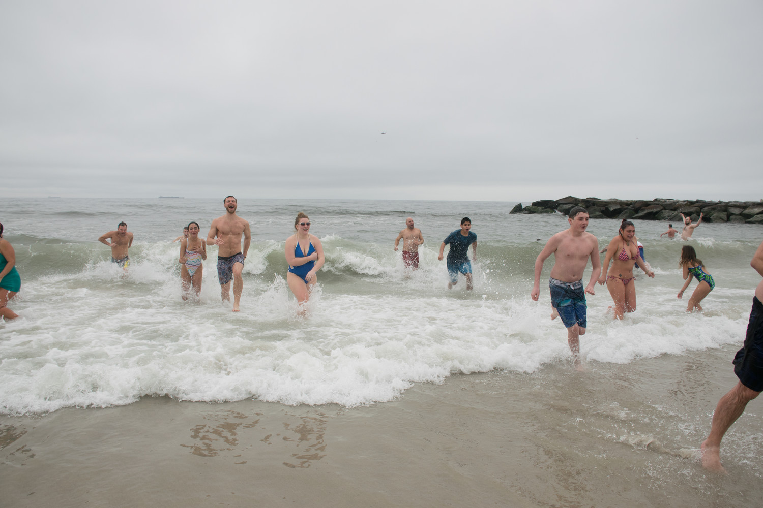 Thousands of people flocked to Long Beach on Sunday to run into the ice-cold Atlantic Ocean and support a good cause.