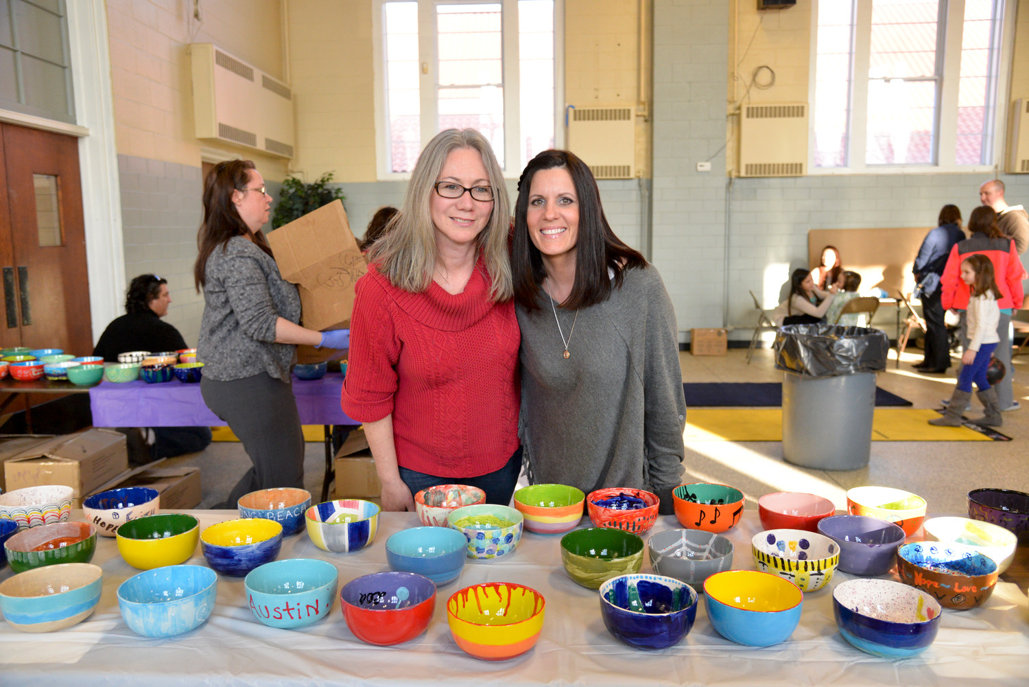 Organizers Michelle Kelly, left, and Debora Staiano at the Empty Bowls fundraiser in 2014.