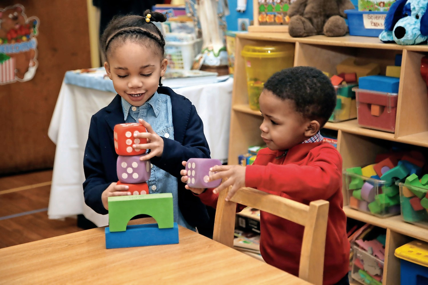 Five-year-old Annalise Bazile and her brother Liam, 3, explore the wonders of kindergarten during Open House at Our Lady of Lourdes School in Malverne.