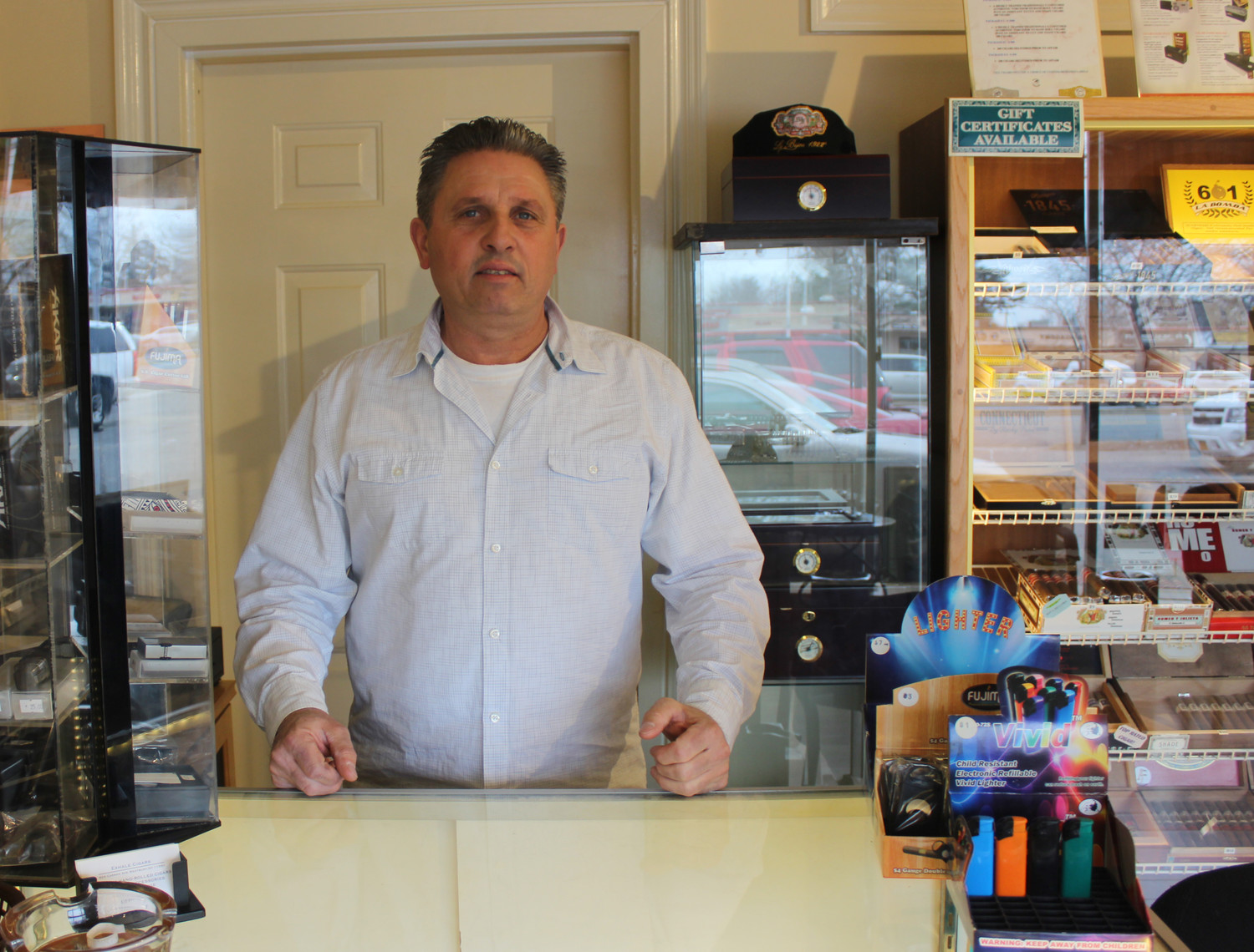 Carmine Crispino, 54, of Merrick, is known locally for his 16-year involvement at Kev's Landscaping and Tress Business in Westbury. Roughly three months ago, he became the co-owner of Exhale Cigars on Carman Avenue.