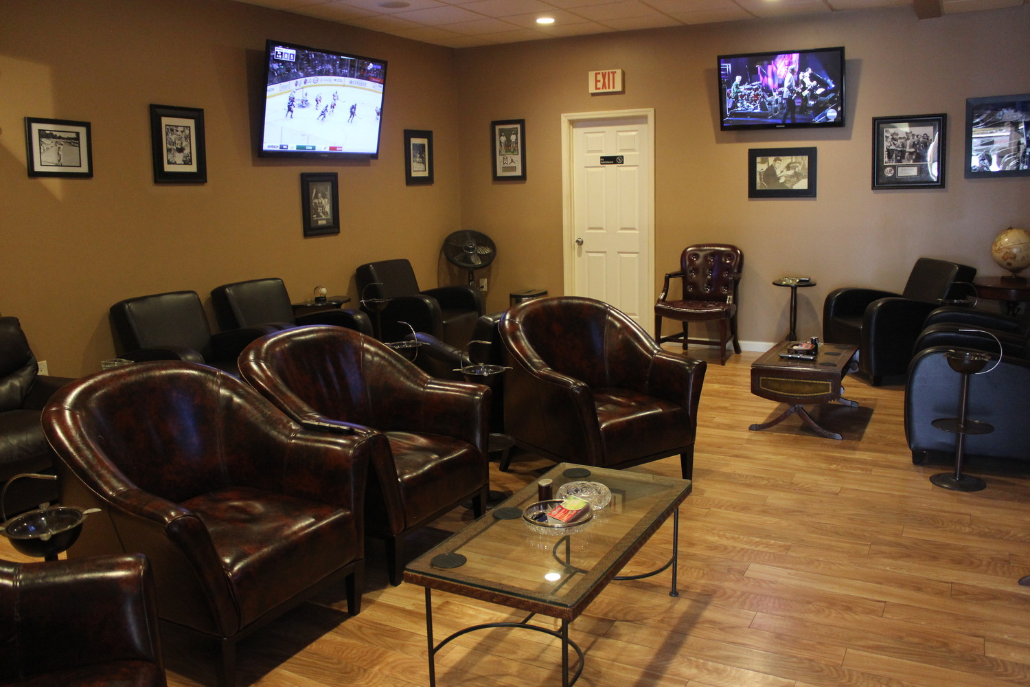 Exhale Cigars' luxury cigar lounge has ten leather couches, three televisions and an electronic fireplace.