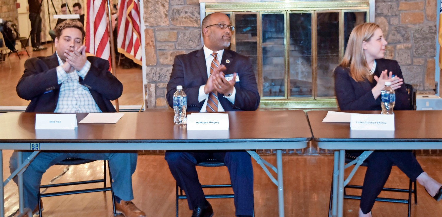 A debate among Mike Sax, far left, DuWayne Gregory and Liuba Grechen Shirley, all running to unseat Peter King in the 2nd Congressional District, heated up at a Democratic candidates' forum in Merrick on Jan. 25.