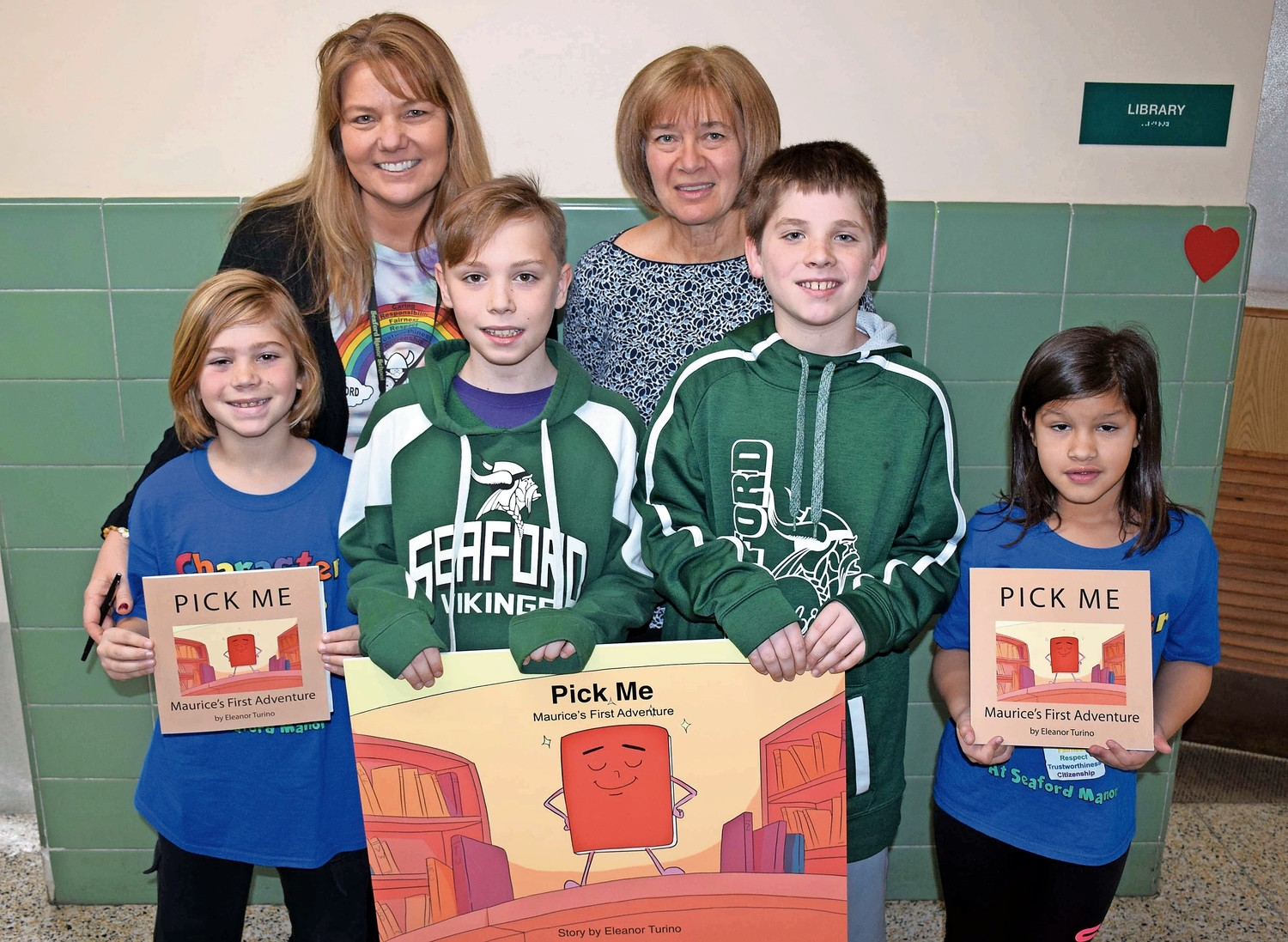 Author Eleanor Turino, standing right, was joined by Principal Debra Emmerich and students, from left, Peter Barone, Chris Curry, Tyler O'Keefe and Olivia Lopez at the PARP kickoff.