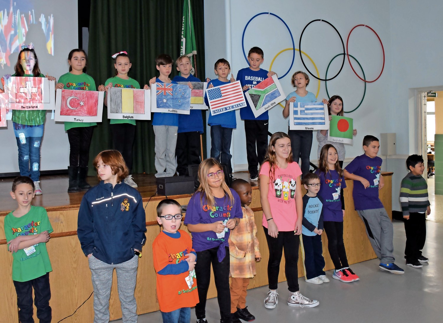 Students celebrated the beginning of Pick A Reading Partners month with an Olympic-themed ceremony.