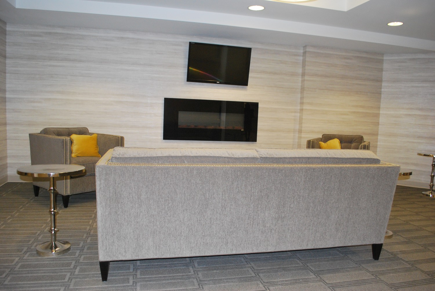 A common area for residents to relax outside their rooms, watch television, read or talk.