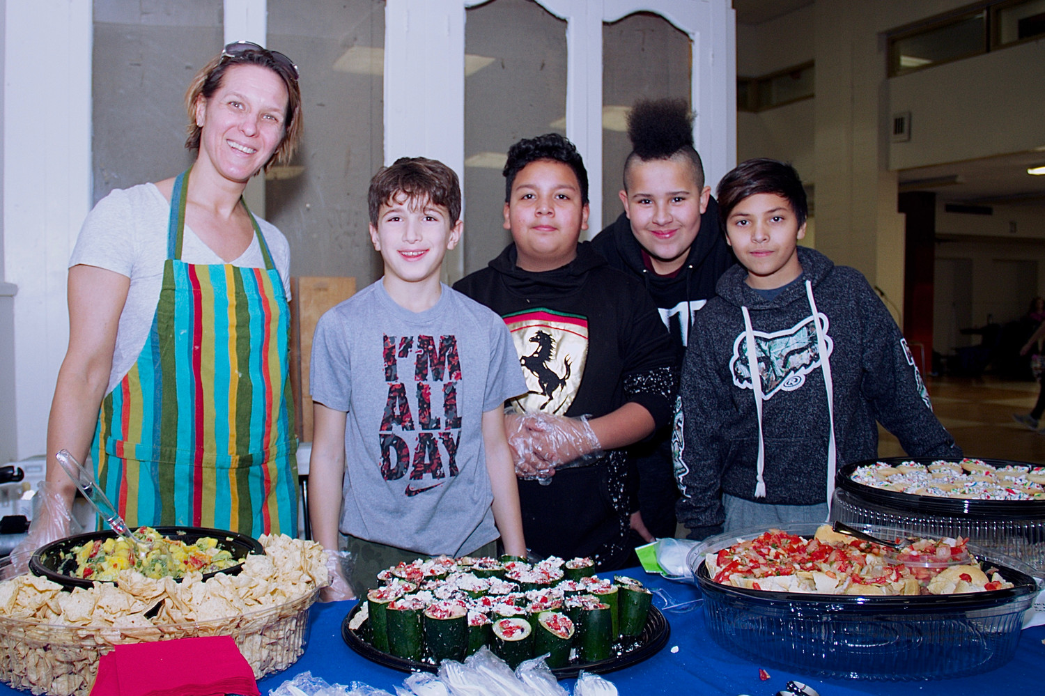 Youth Program Coordinator Jacki Yonick, right, 6- and 7-graders Pandelis Tursi, Luis Cruz, Rodni Leftwich, and Brandon Curcio, show off the healthy snacks they had made for the student showcase.