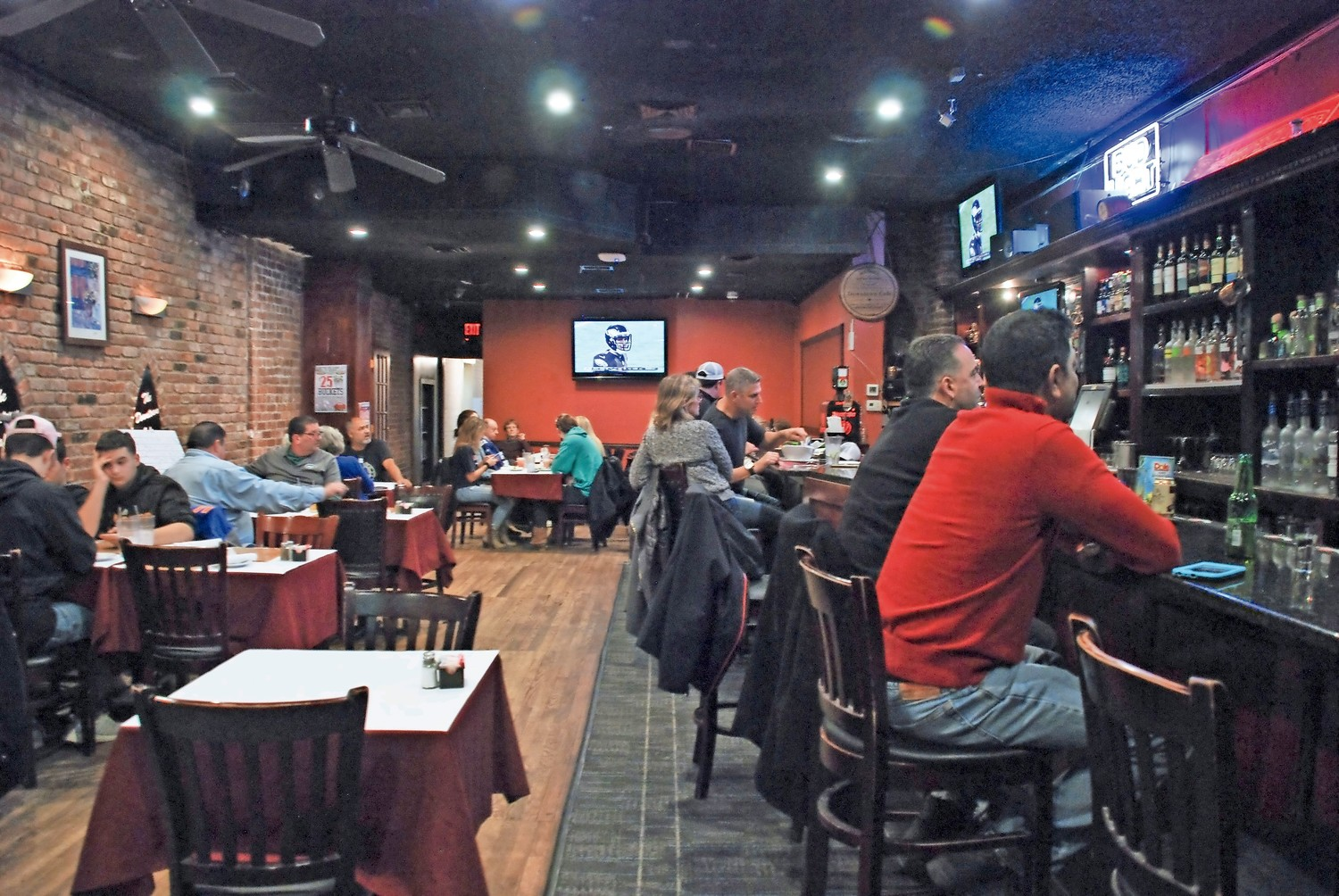 Revved up residents gathered at The Downtown Café in Glen Cove to watch the big game.