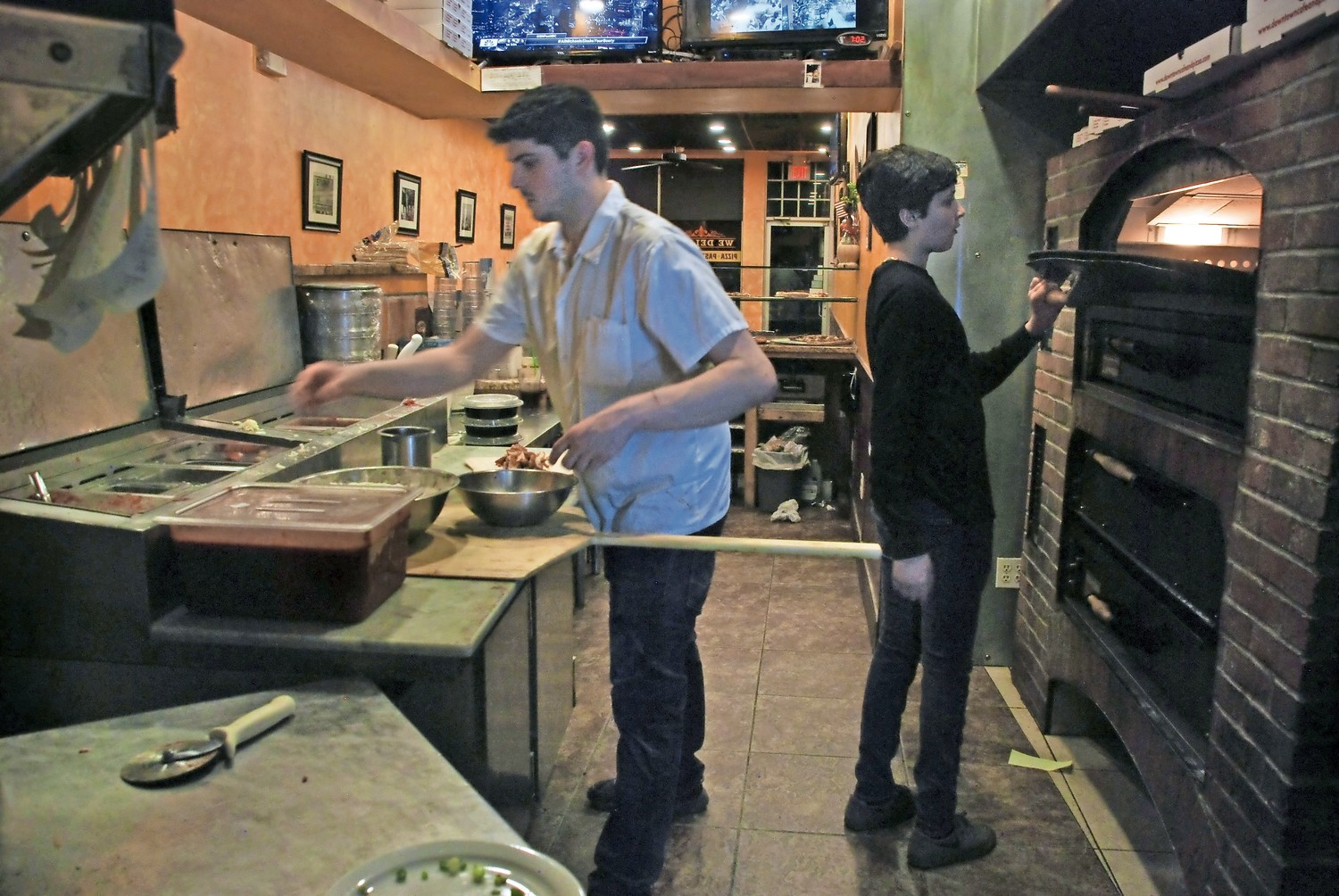 Downtown's chefs cranked out brick-oven pizzas for hungry game day customers.