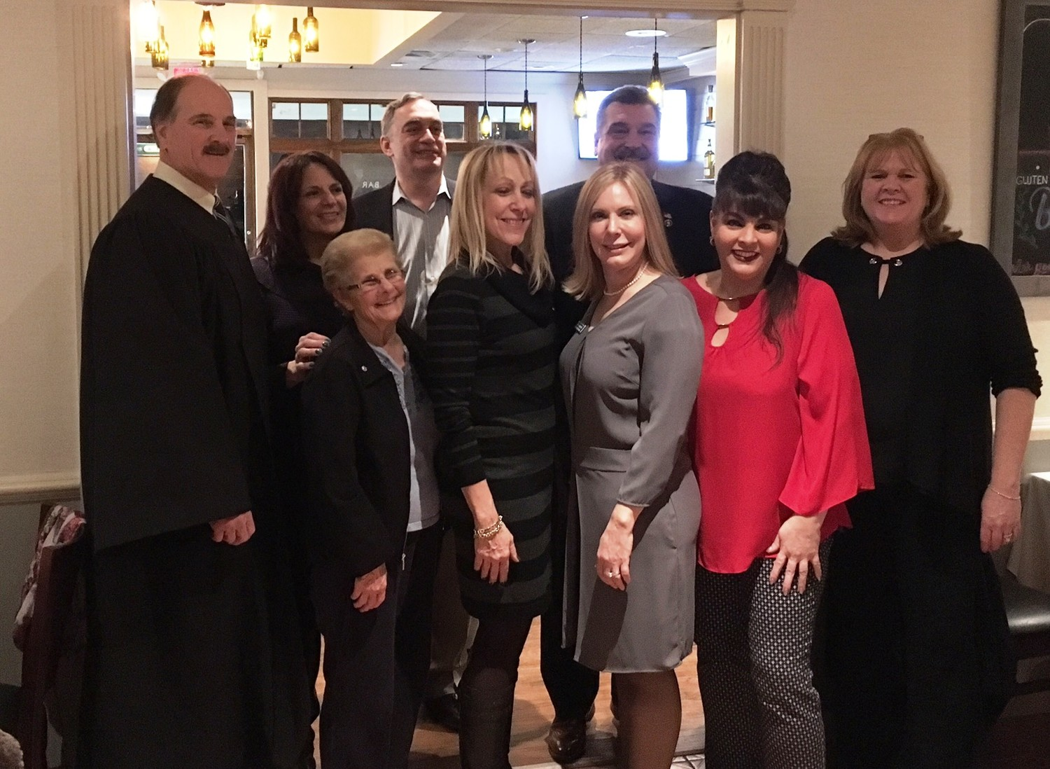 Judge Richard McCord, front-left, Carol Nelson, chamber president Lisa Cohn, Vice President Eve Lupenko, Mary Stanco and Deputy Mayor Maureen Basdavanos, Dr. Maxine Cappel-Mayreis, back-left, Tom Bunger, the chamber's treasurer and Glen Cove Mayor Tim Tenke.