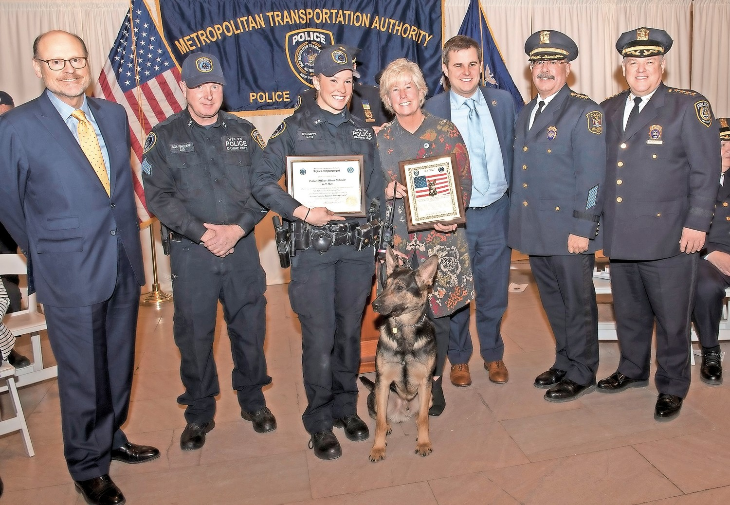 Alison Schmitt, third from left — who grew up in Malverne — graduated from the MTA Police Department's explosive detection program on Jan. 31.