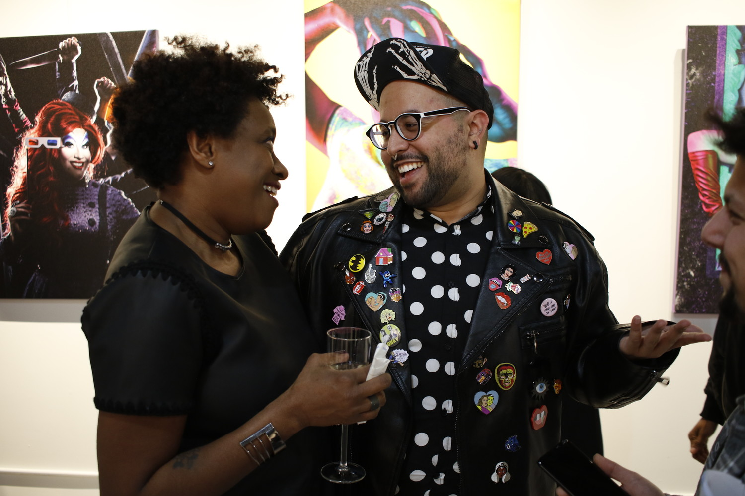 Freeport native David Ayllon, right, held his first ever gallery opening at POP in Baldwin which is owned by his friend Dawn Maison, left. The drag portraits, his first ever photography project, were a huge hit with the attendees.